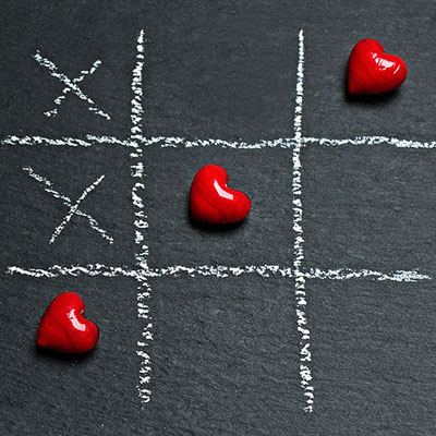 Tic Tac Toe game with winning row of hearts